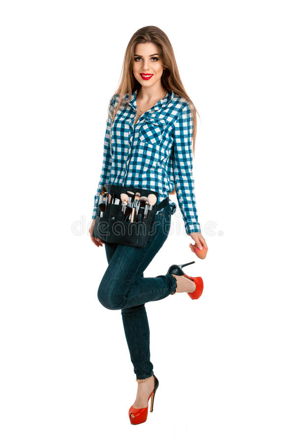 Fashion portrait of young beautiful makeup artist in studio stock photo