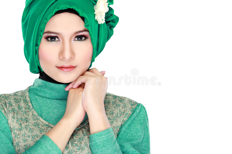 Fashion portrait of young beautiful muslim woman with green cost. Ume wearing hijab isolated on white background royalty free stock images