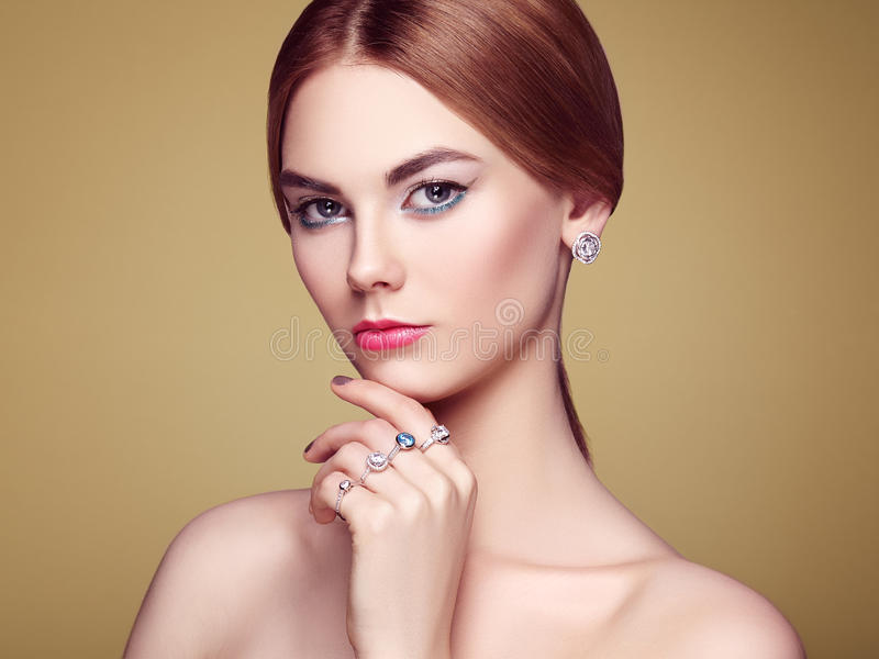 Fashion portrait of young beautiful woman with jewelry royalty free stock images