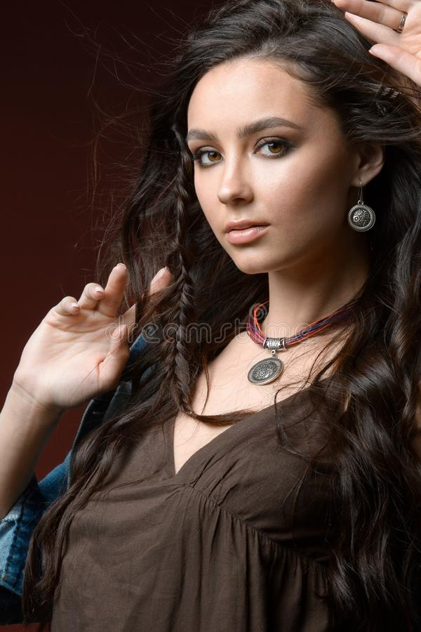 Fashion portrait of young beautiful woman with jewelry. Brown hair girl. Perfect makeup. Beauty style girl with accessories royalty free stock photography