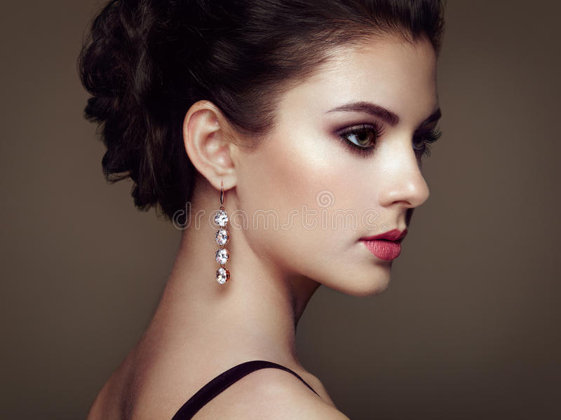 Fashion portrait of young beautiful woman with jewelry royalty free stock photo