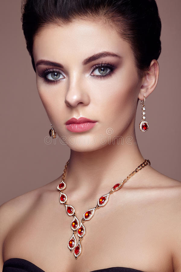 Fashion portrait of young beautiful woman with jewelry royalty free stock photography