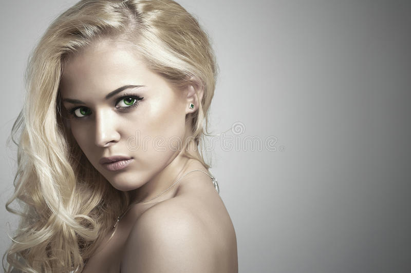 Fashion portrait of young beautiful woman.Sexy Blond girl.Your text here royalty free stock photography
