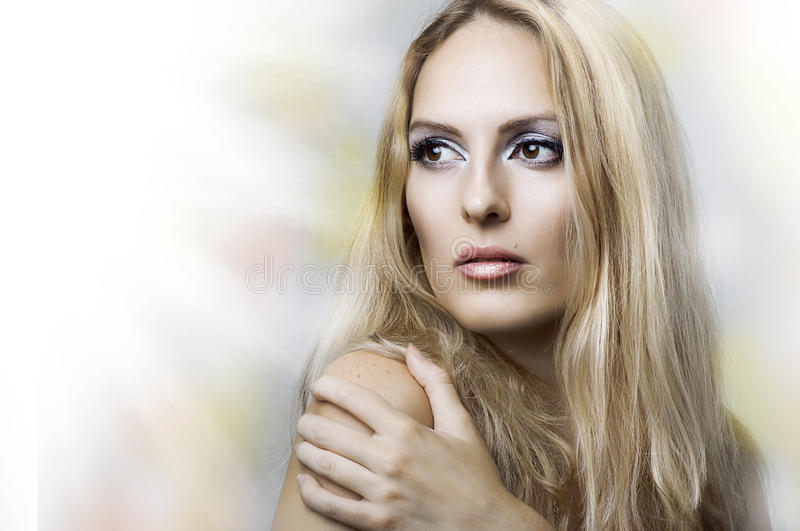 Fashion portrait of young beauty woman face. stock photo