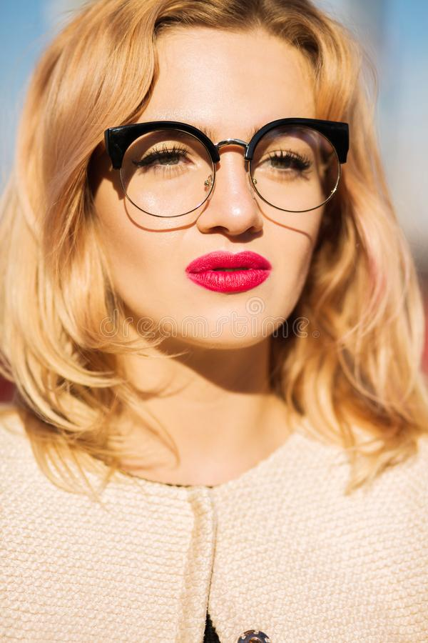 Fashion portrait of young blonde model with bright makeup and lu stock image