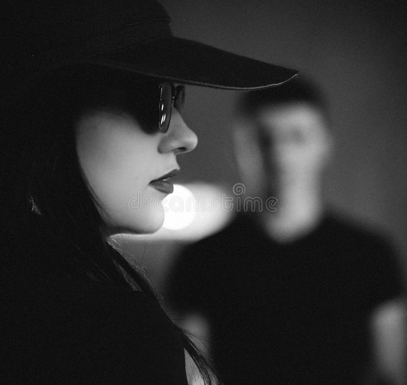 Portrait of a young girl in a hat and glasses royalty free stock images