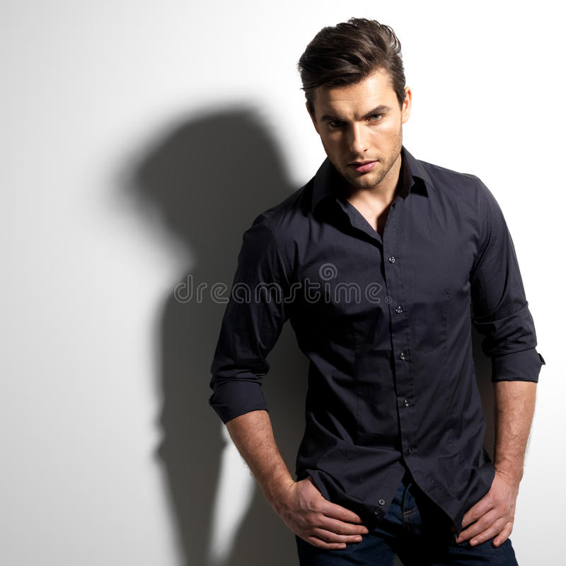 Download Fashion Portrait Of Young Man In Black Shirt Stock Image - Image of hairstyle, male: 29258075