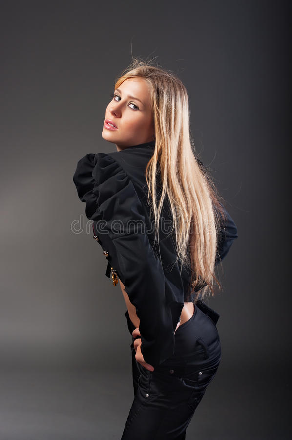 Fashion portrait of young woman royalty free stock photography
