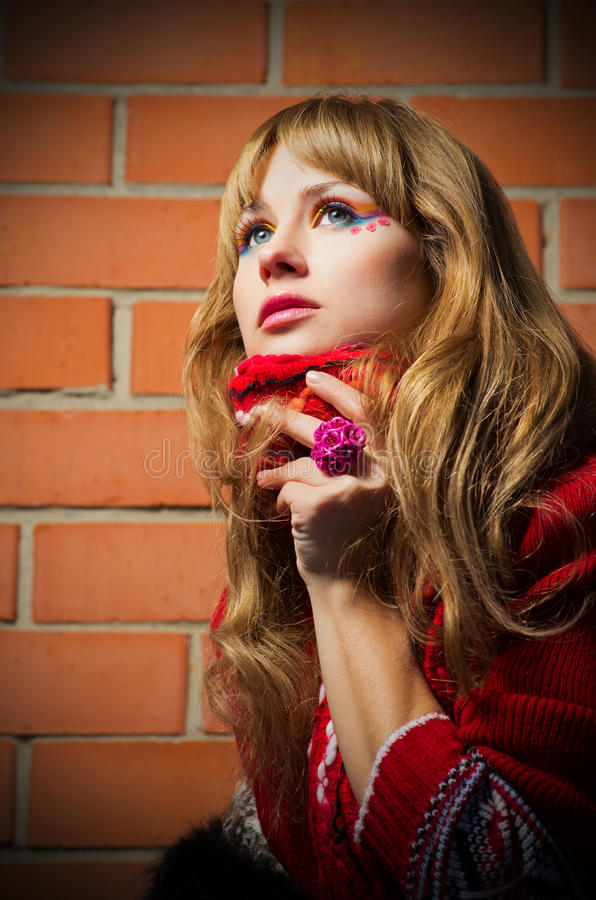 Fashion portrait of young woman on brick wall background royalty free stock photos