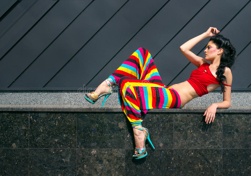Fashion portrait of young woman in color outfit stock image