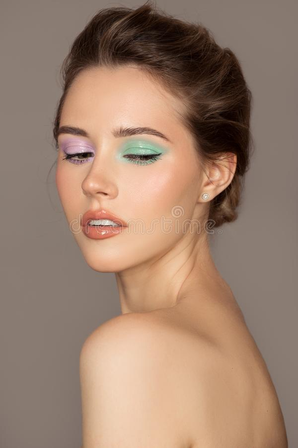 Fashion portrait of young woman. Colorful eye shadows. Perfect skin stock image