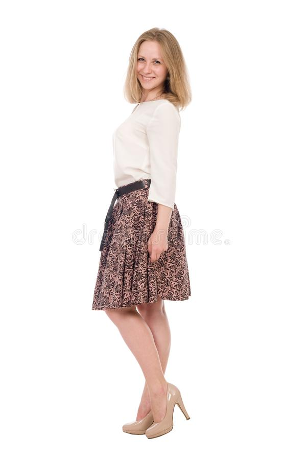 Fashion portrait young woman in skirt posing full length isolated over white royalty free stock photos