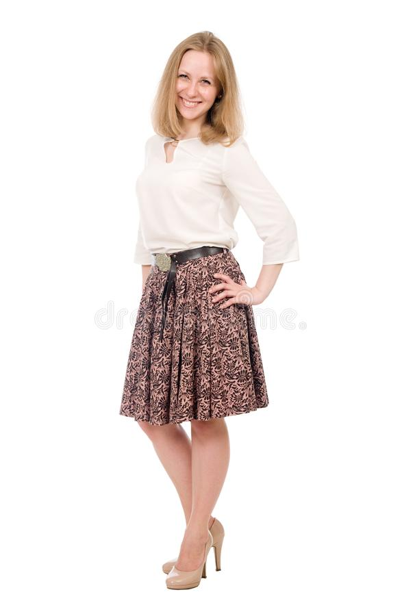 Fashion portrait young woman in skirt posing full length isolated over white stock image