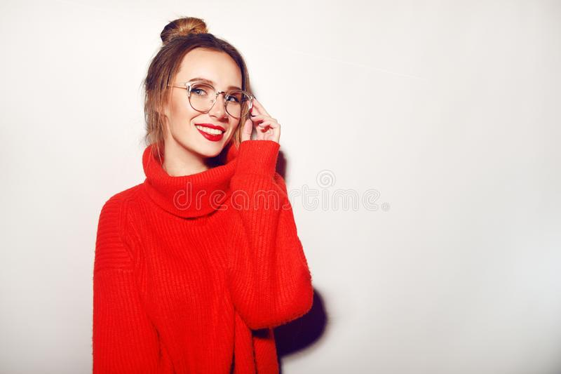 Fashion pretty cool girl wearing glasses and red sweater. Close up shot of charming female. Tender, beautiful, young. Hipster. Cut royalty free stock photos