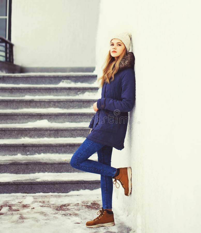 Fashion pretty cool girl wearing jacket and hat in winter stock images