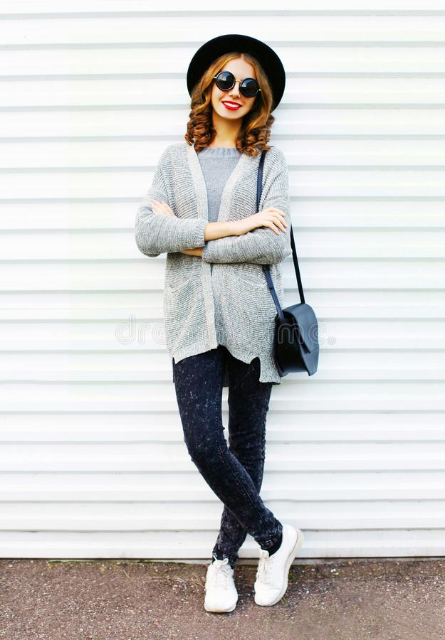 Fashion pretty smiling woman with a black handbag on a white stock photography