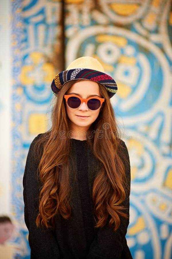 Fashion pretty young woman model wearing a retro elegant hat, sunglasses royalty free stock images