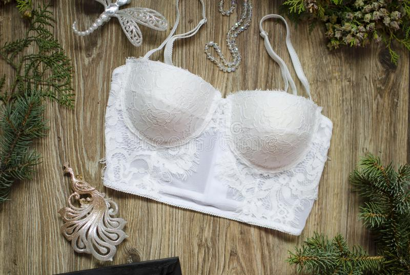 Fashion Push Up bra and panties set on the wooden festive background. Merry Christmas gift for women. stock photos