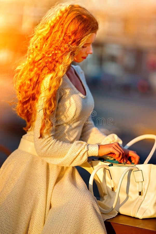 Fashion red woman in autumn spring dress on city street. stock photo