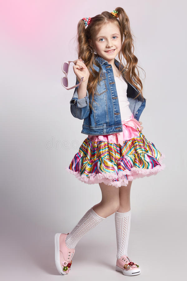 Fashion redhead girl in a festive outfit posing and smiling. Studio photo on light coloured background. Birthday, holiday.  stock photos