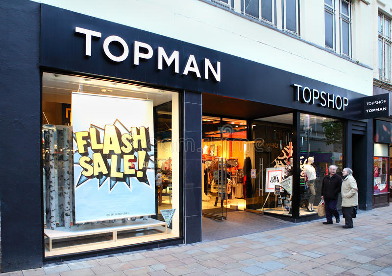 Fashion retailer Topman. Topman and Topshop store front with flash sale sign. A fashion retailer that is part of the larger Arcadia group. Wolverhampton, UK royalty free stock photos