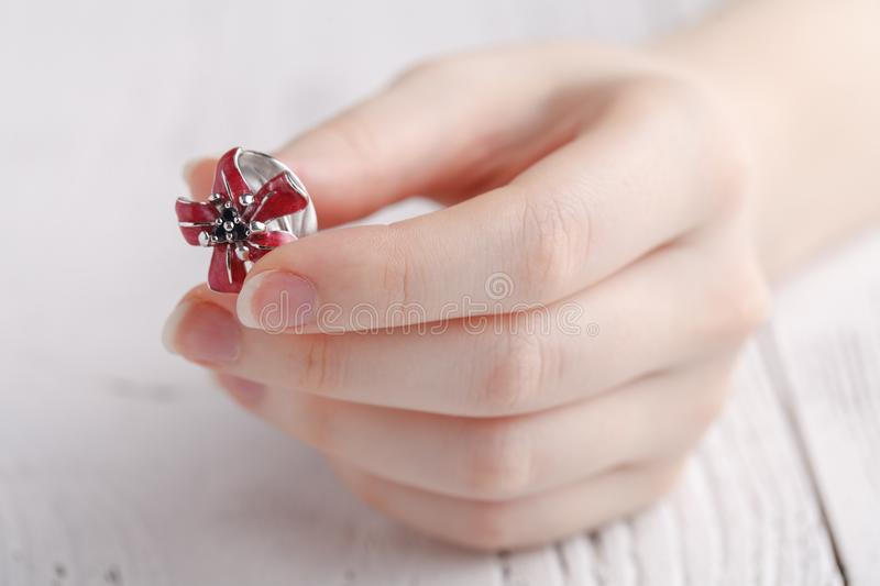 Fashion ring in female hands, close up stock image