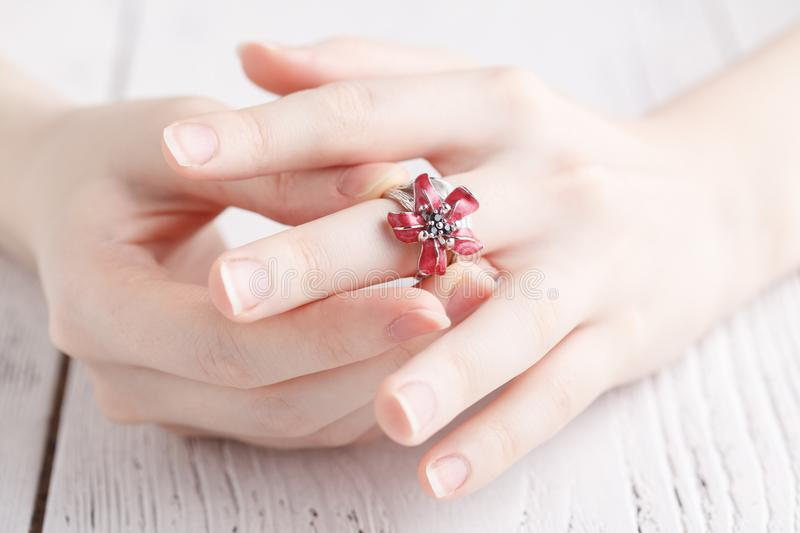 Fashion ring in female hands, close up stock photography