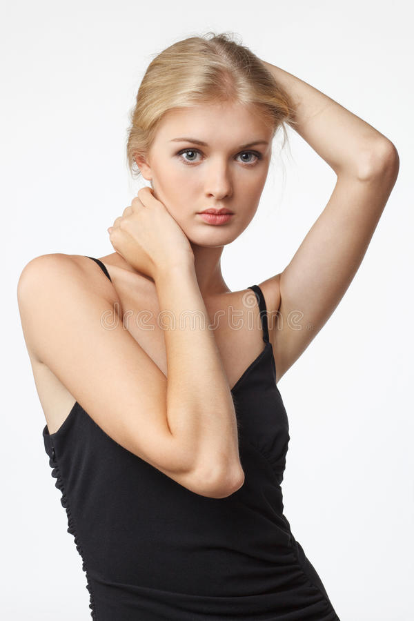 Fashion sensual blond woman in black dress stock image
