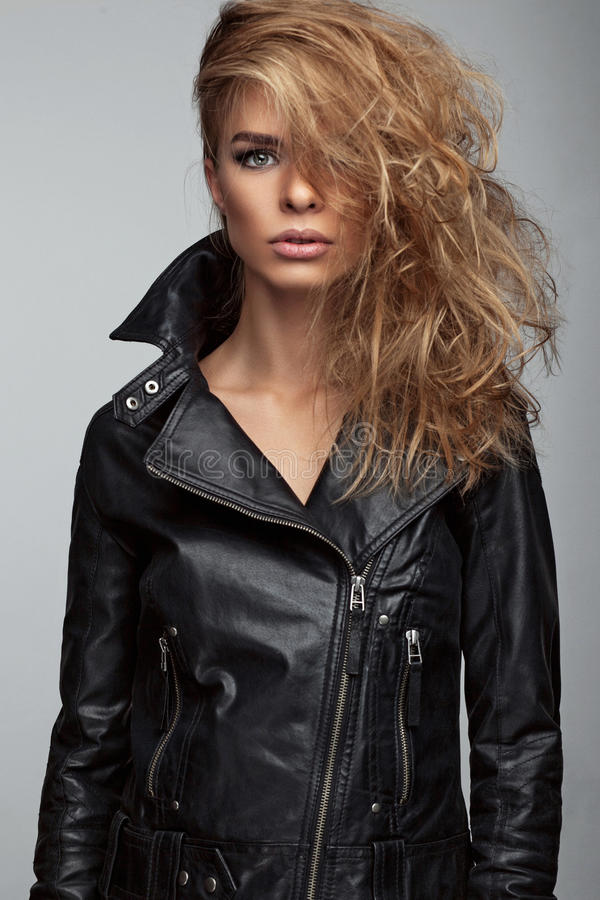 Fashion shoot of girl with beautiful hair style in a leather jacket. royalty free stock photos