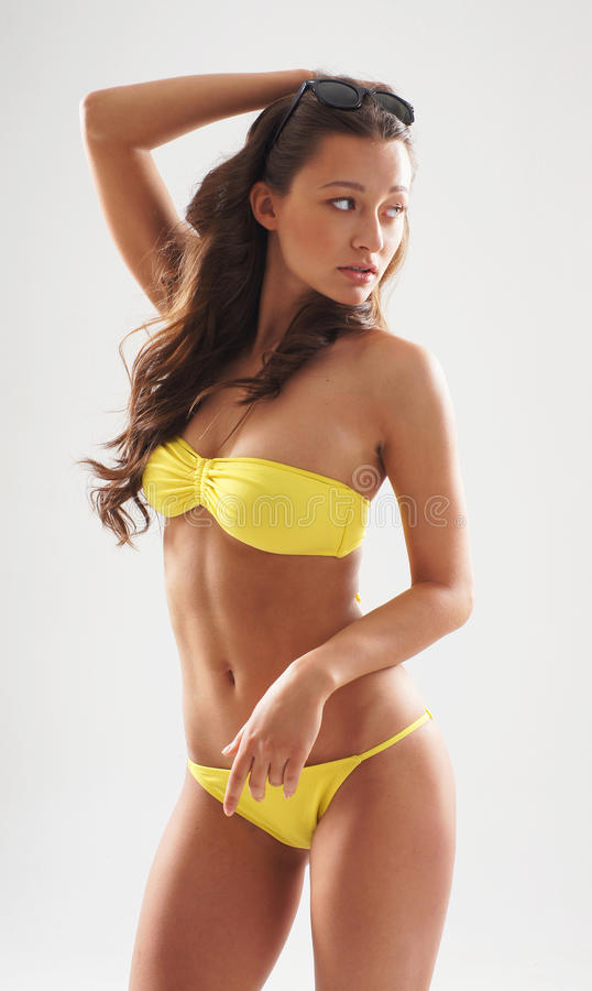 Download Fashion Shoot Of A Woman In A Yellow Swimsuit Stock Image - Image: 19541561