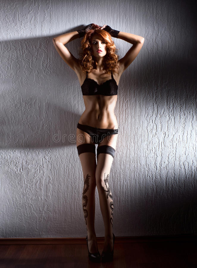 Download Fashion Shoot Of A Young Redhead Woman In Lingerie Stock Photos - Image: 26536743