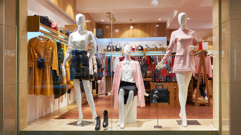Fashion shop window clothing store front. View of womens fashion clothing store front, Woman mannequin in fashion clothing retail shop window royalty free stock photography