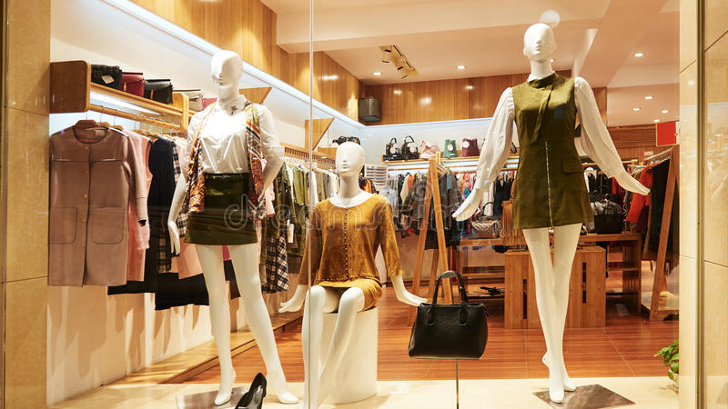 Fashion shop window clothing store front royalty free stock photo