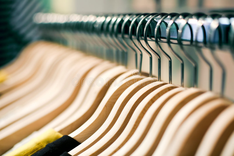 Fashion shopping concept - hangers. Clothes hangers with shirts in a store ready to sell. Fashion shopping store concept royalty free stock images
