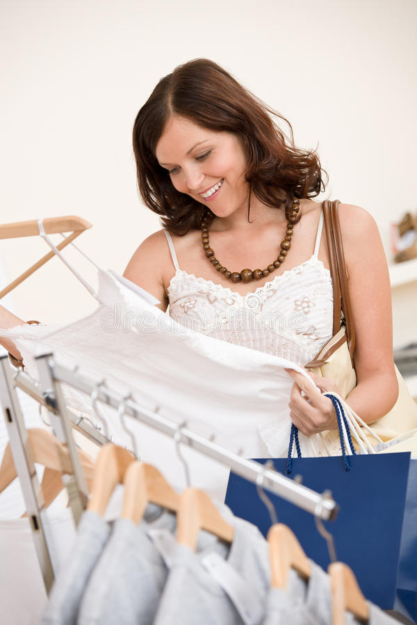 Fashion shopping - Happy woman choose clothes stock images