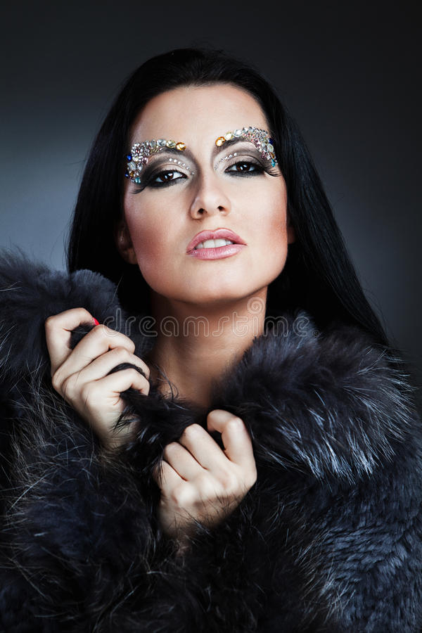 Glamorous caucasian woman with jewelry royalty free stock photography