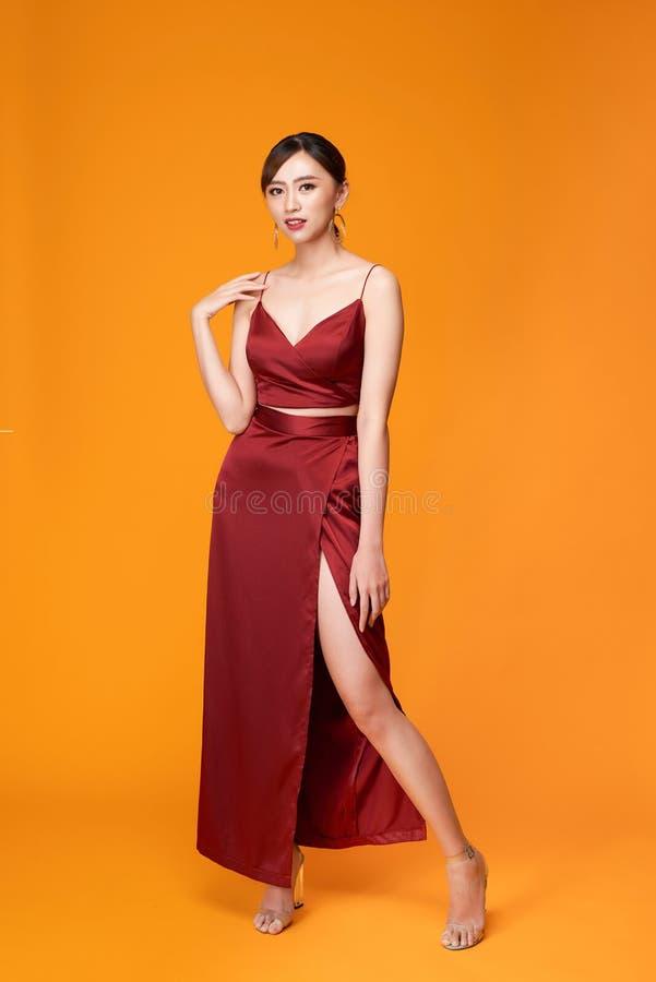 Fashion shot of the elegant woman in beautiful long dress posing in motion stock image
