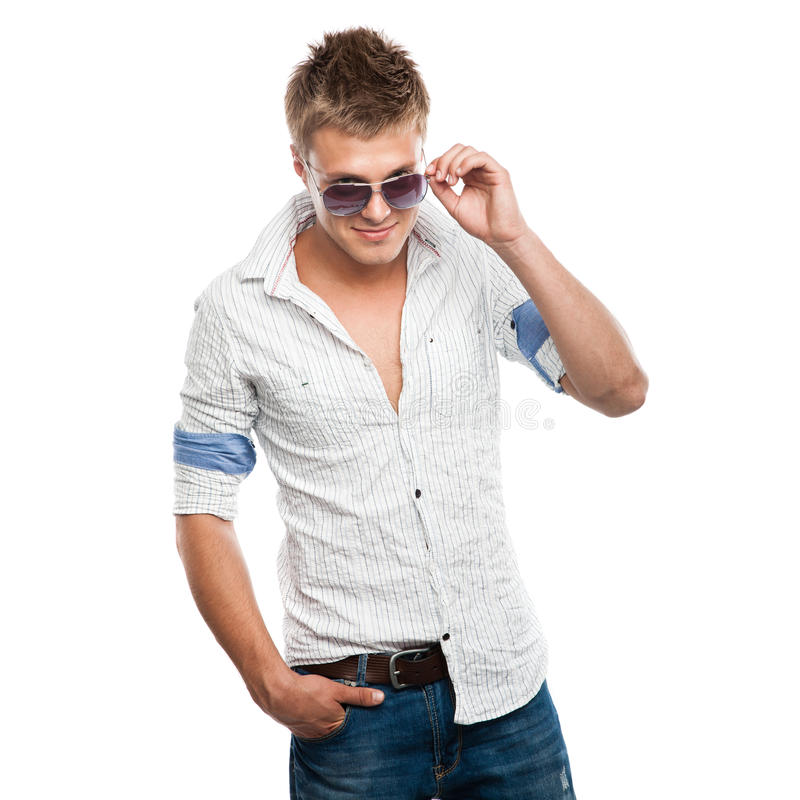 Fashion shot of an elegant young man in sunglasses royalty free stock photography