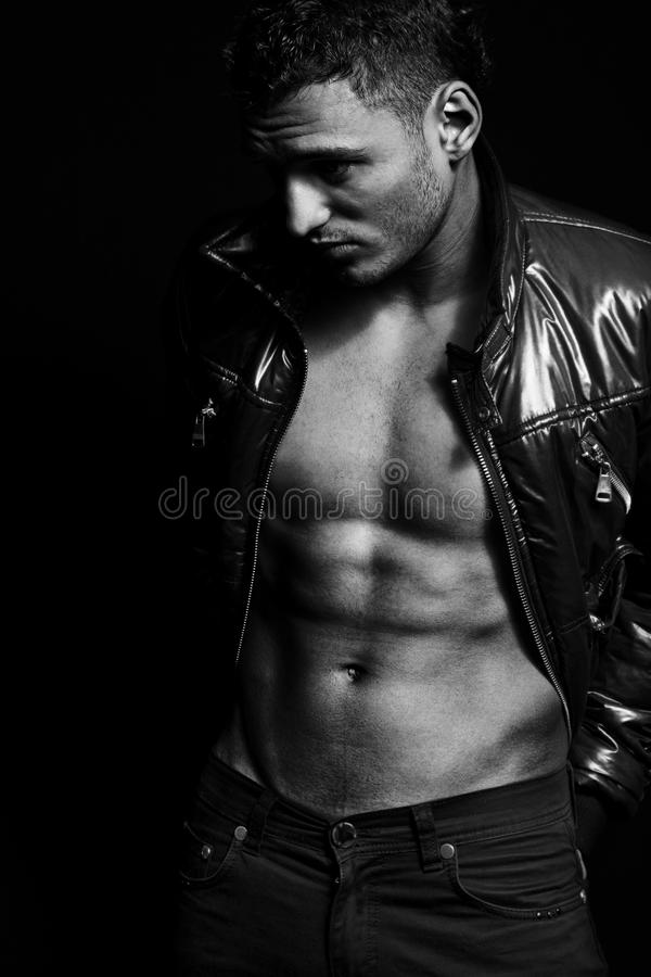 Fashion shot of muscular handsome man stock photography