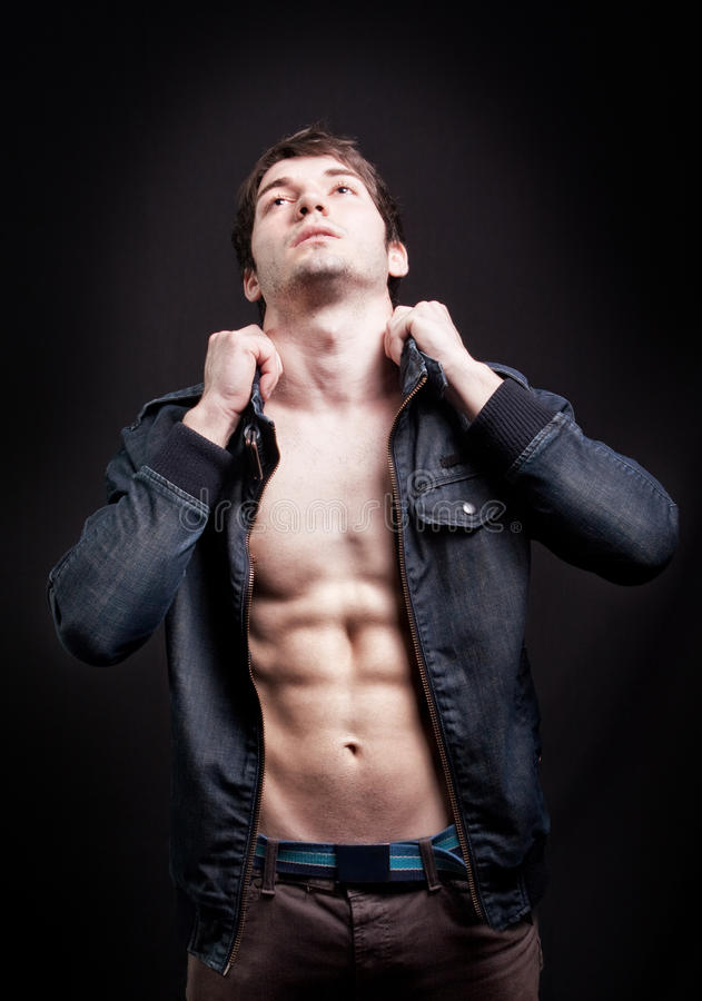 Fashion shot of man with fit abs royalty free stock photography