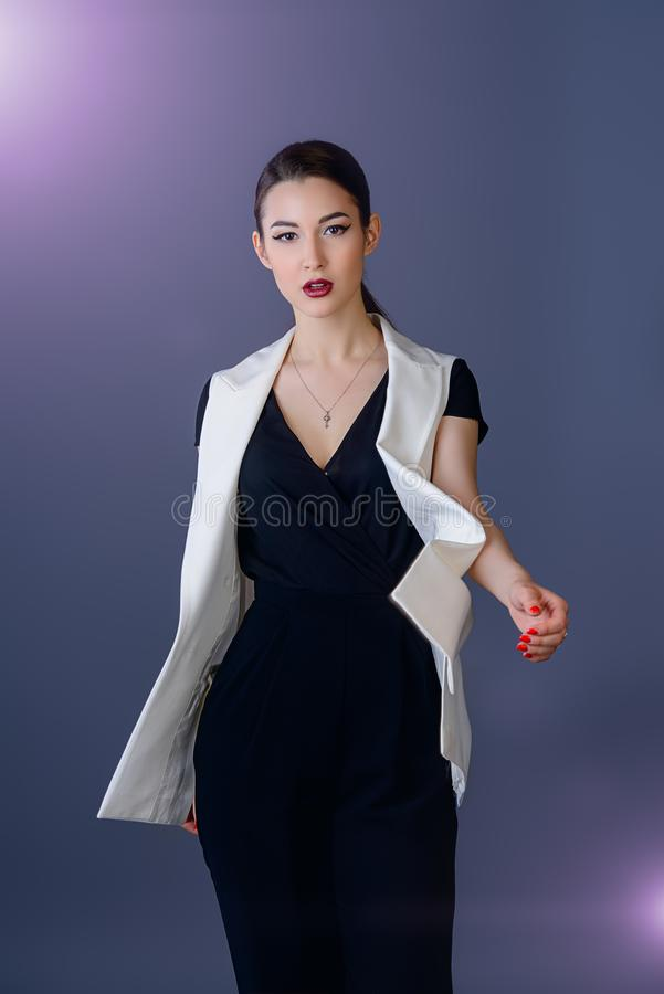 Fashion shot at studio. Fashion shot. Professional vogue model posing at studio. Collection of business clothes royalty free stock image
