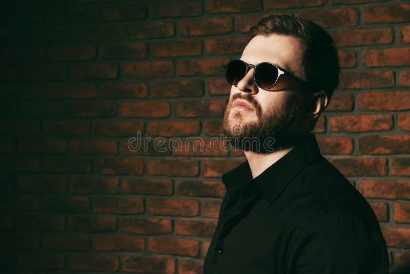 Brutal man in black stock photo