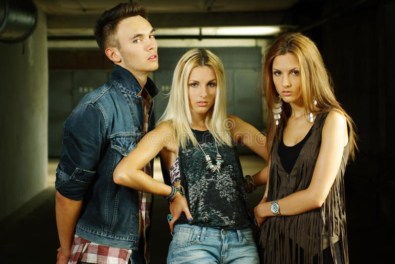 Fashion shot of a trendy of young people. Fashion shot of a trendy group of young people stock image