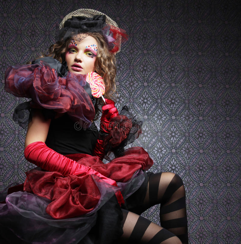 Fashion shot of woman in doll style. Creative make-up.Fantasy dr royalty free stock photo