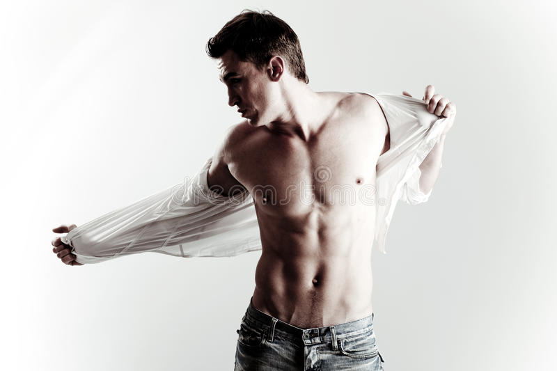 Fashion shot of young male model stock images