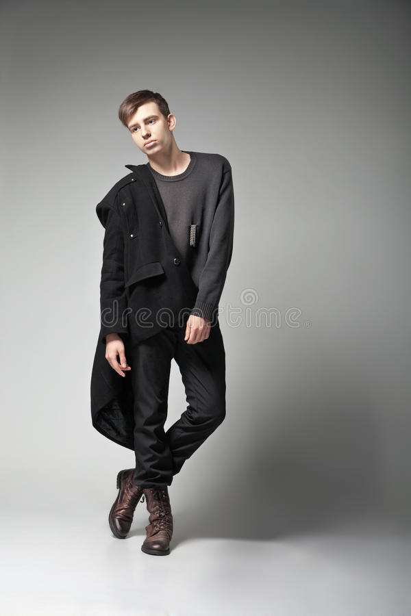 Download Fashion Shot Of A Young Man In Coat Royalty Free Stock Photo - Image: 29864805