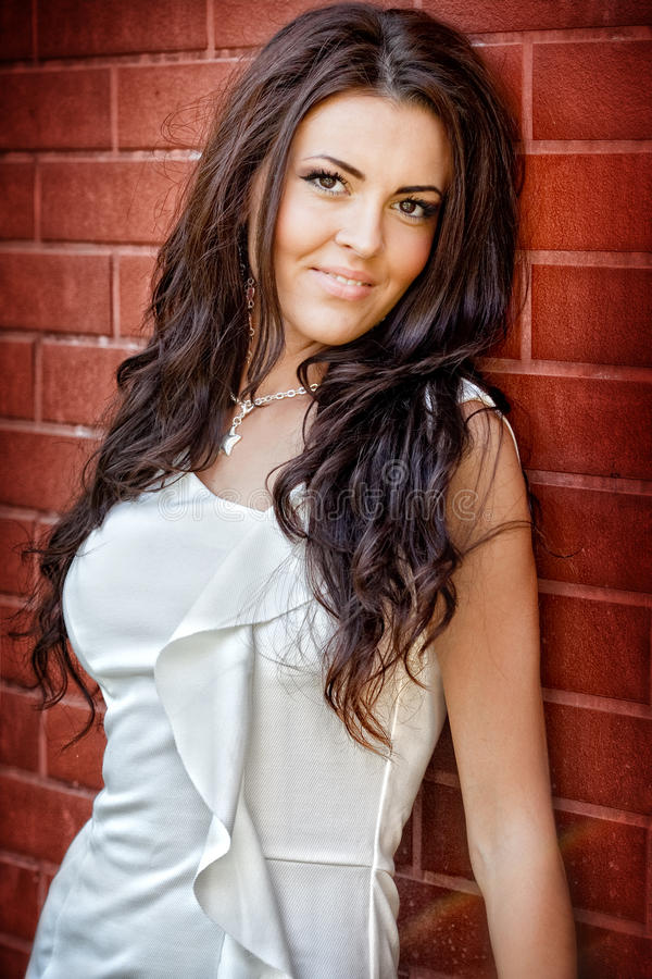 Fashion shot of young brunette woman royalty free stock photo