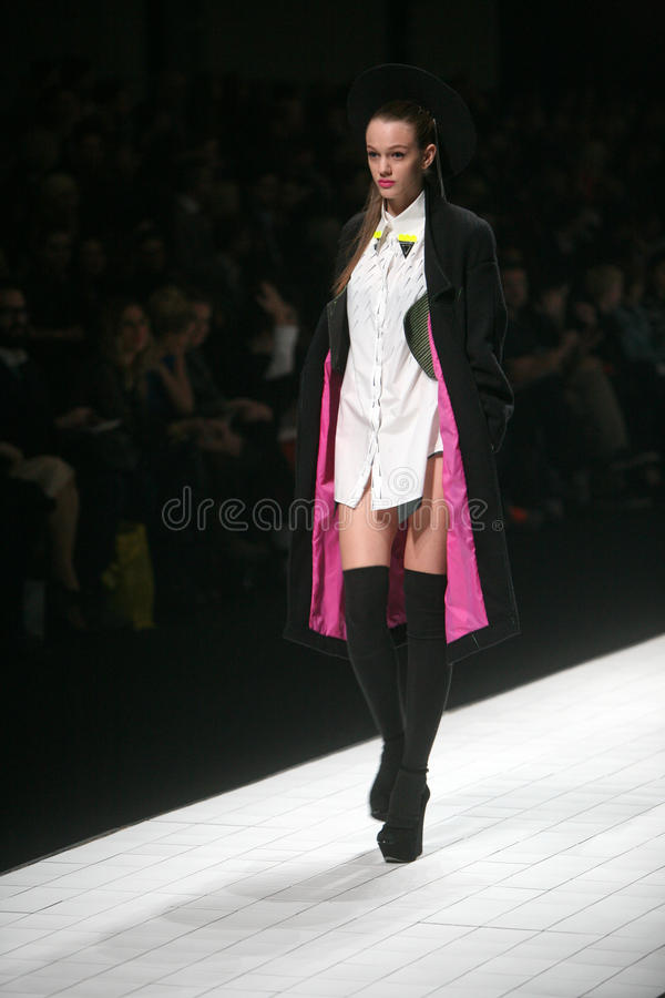 Fashion Show. ZAGREB, CROATIA - MARCH 15: Fashion model wears clothes made by design group Clash of 9 on Dove FASHION.HR show on March 15, 2012 in Zagreb stock image