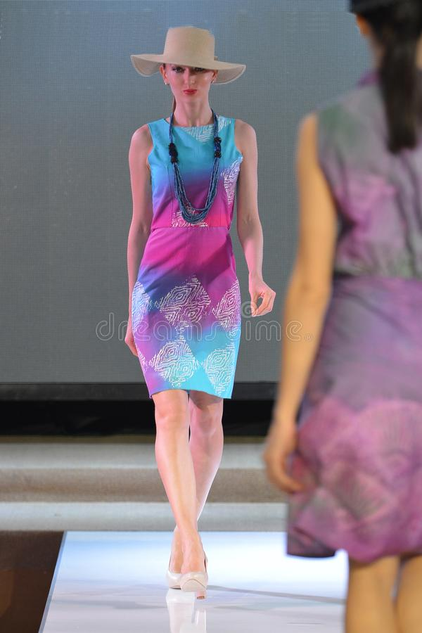 Fashion show - Catwalk. Modal with batik dress in action royalty free stock photos