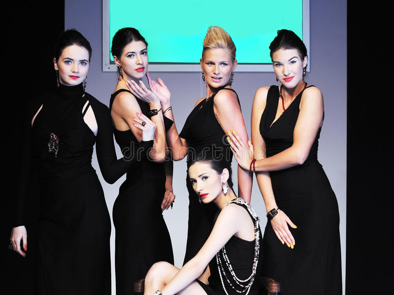 Fashion show woman. Young models group posing on fashion show piste stock photo
